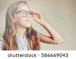 little kid girl looking happy... | Shutterstock . vector #586669043