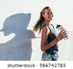 shot of beautiful female runner ... | Shutterstock . vector #586742783