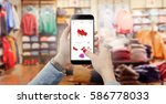 woman in clothing store holding ... | Shutterstock . vector #586778033