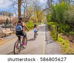 biking on urban bike path | Shutterstock . vector #586805627