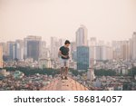 asian young man in the top of...   Shutterstock . vector #586814057