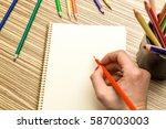 school supplies on wooden...   Shutterstock . vector #587003003