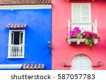 Bright Blue And Pink Houses...