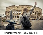 woman tourist near the coliseum ... | Shutterstock . vector #587102147