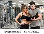 personal trainer and client... | Shutterstock . vector #587105867