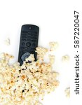 Black Tv Remote And Popcorn On...