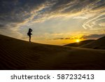 Gril Sihouette Sand Dunes...