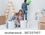 young family doing a home... | Shutterstock . vector #587257457