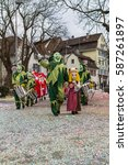 Small photo of On carnival in Switzerland already on the first day all ground is covered with confetti