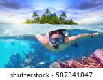 young woman at snorkeling in... | Shutterstock . vector #587341847
