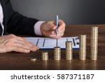 businessman calculating... | Shutterstock . vector #587371187