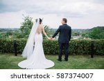 beautiful and young bride and... | Shutterstock . vector #587374007