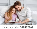 happy young father reading book ... | Shutterstock . vector #587399267