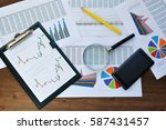 financial printed paper charts  ... | Shutterstock . vector #587431457