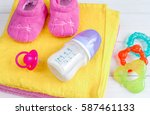 baby bottle with milk and towel ... | Shutterstock . vector #587461133
