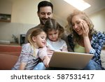 happy family spending time at... | Shutterstock . vector #587531417