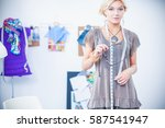 young fashion designer working... | Shutterstock . vector #587541947