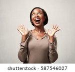 happy black woman | Shutterstock . vector #587546027
