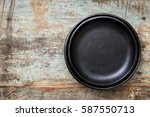 empty rustic black plates over... | Shutterstock . vector #587550713