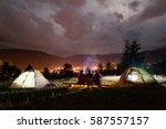 three tourists sitting on... | Shutterstock . vector #587557157