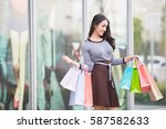 asia woman holding many... | Shutterstock . vector #587582633