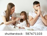 ill family in bad at home | Shutterstock . vector #587671103