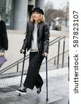 Small photo of PARIS-MARCH 2, 2016. Stylist Alexandra Golovanoff is going to a fashion show. Paris fashion week.
