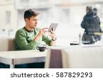 young man using tablet computer ... | Shutterstock . vector #587829293