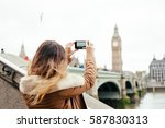 tourist snapping taking a photo ... | Shutterstock . vector #587830313
