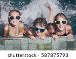 three happy children  playing... | Shutterstock . vector #587875793
