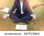 businessman is meditating to... | Shutterstock . vector #587919863