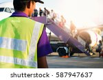 airport staff looking at... | Shutterstock . vector #587947637