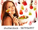 healthy eating    woman eats a... | Shutterstock . vector #587956997
