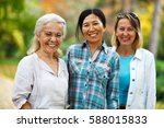 three mature ladies looking at... | Shutterstock . vector #588015833