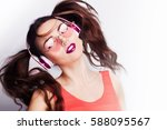 woman listening to music on... | Shutterstock . vector #588095567