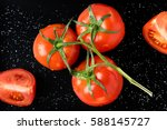 a branch of fresh red tomatoes... | Shutterstock . vector #588145727