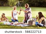 family picnic outdoors... | Shutterstock . vector #588222713