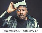 young man wearing virtual... | Shutterstock . vector #588389717