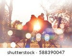tourists photograph the sunrise ... | Shutterstock . vector #588390047