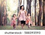 mother and children daughter... | Shutterstock . vector #588393593