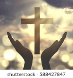 human hands praying to the god... | Shutterstock . vector #588427847
