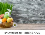 easter painted eggs and flowers ... | Shutterstock . vector #588487727