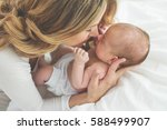 mother with a baby | Shutterstock . vector #588499907