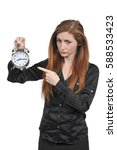 Small photo of Woman counting the time on an alarm clock