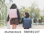 cute asian children  holding... | Shutterstock . vector #588581147