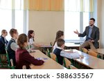 pupils listening teacher in... | Shutterstock . vector #588635567