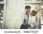 couple standing by the window... | Shutterstock . vector #588675287