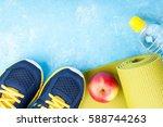 yoga mat  sport shoes  apples ... | Shutterstock . vector #588744263