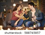 couple feeding each other over... | Shutterstock . vector #588765857