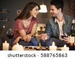 attractive couple trying to... | Shutterstock . vector #588765863
